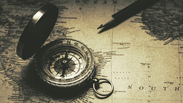 Old compass on antique map. - vintage background style. Premium Photo