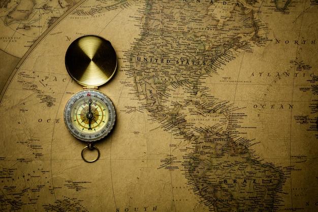 Old compass on antique map. Premium Photo