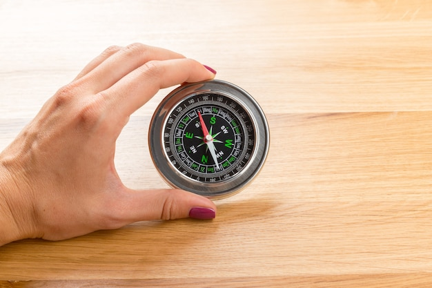 Old compass on a wooden background Premium Photo