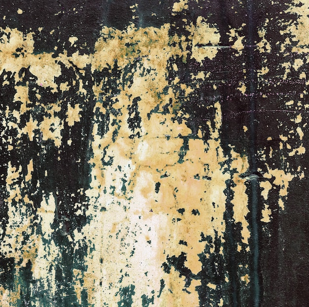 Old concrete wall stained with yellow paint Premium Photo