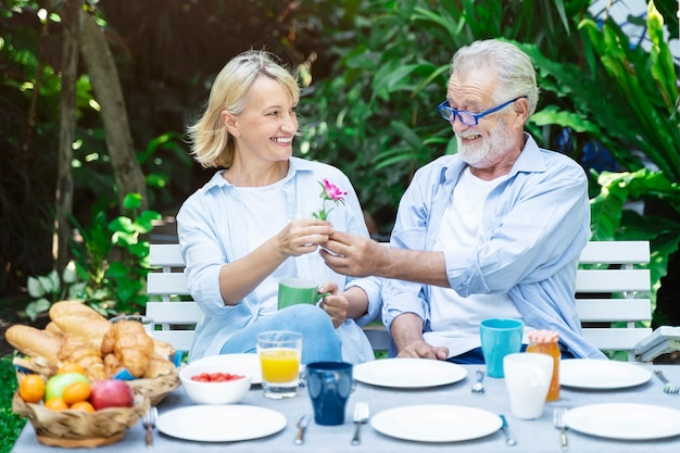 Old couple people dating with happiness together in garden, Premium Photo
