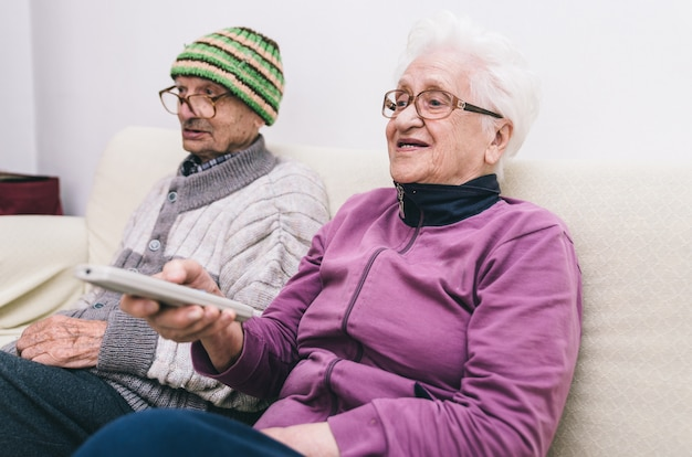 Old couple watching television Premium Photo