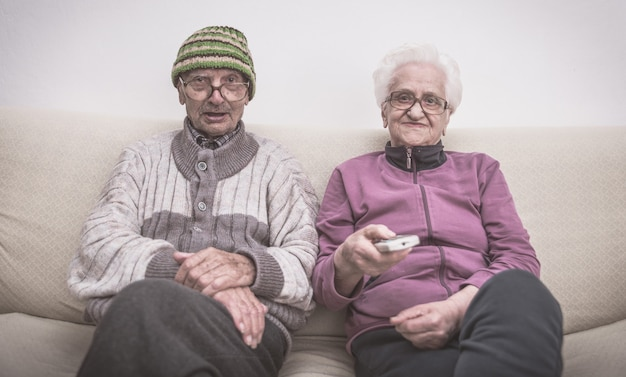Old couple and zapping Premium Photo