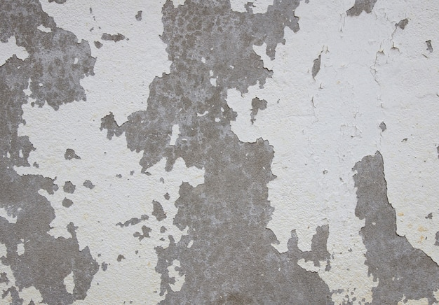 Old cracked paint on the concrete wall Premium Photo