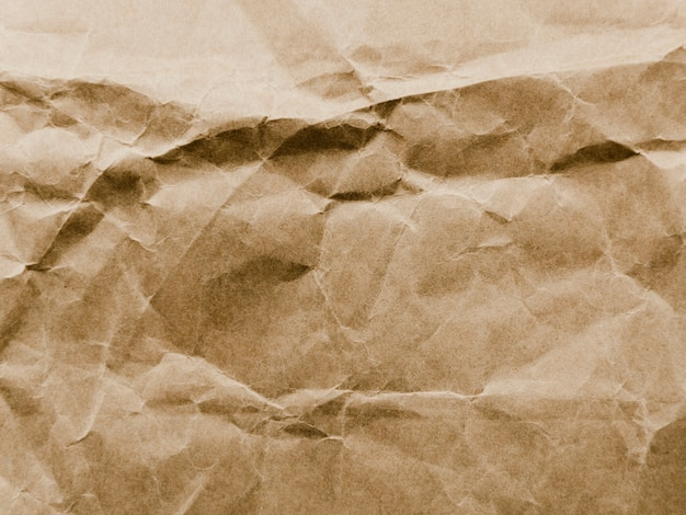 Old crumpled parchment paper texture Free Photo
