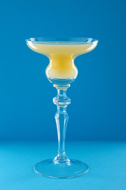 Old cuban cocktail on blue background Premium Photo