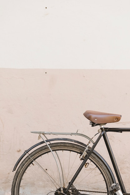 Old cycle parked near concrete wall Free Photo