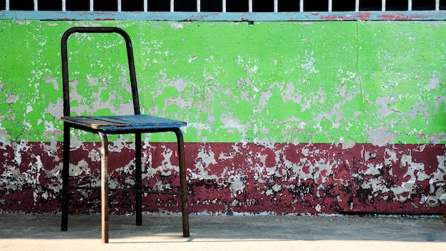 Old and damaged steel chair in rural school Premium Photo
