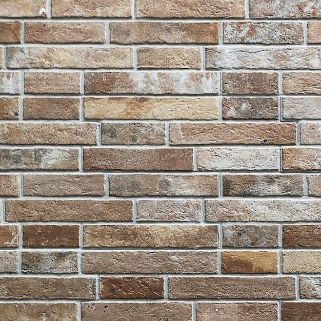 Old dark red brown tone brick wall texture Free Photo