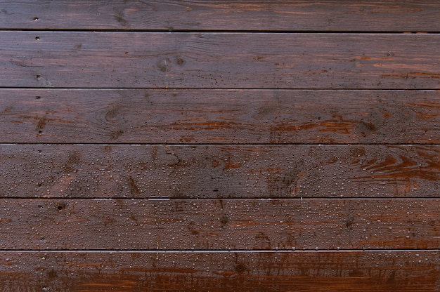 Old dark wooden wall with raindrops background texture Premium Photo