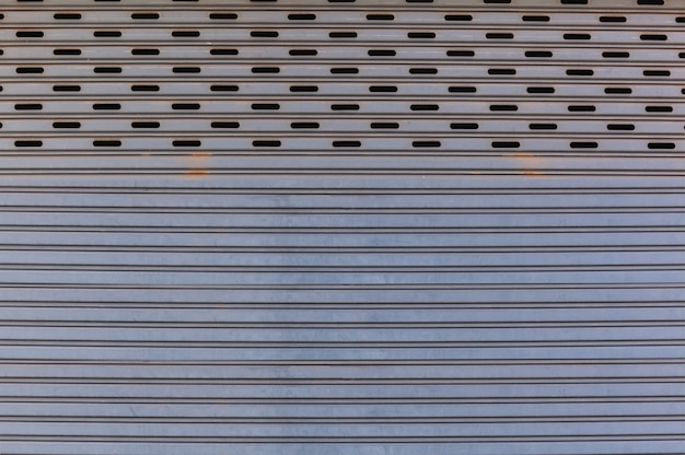 Old detail aged vintage textured zinc alloy metal roller shutter door, exterior design Premium Photo