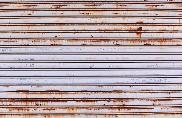 Old detailed aged vintage rusty textured zinc alloy metal roller shutter door Premium Photo
