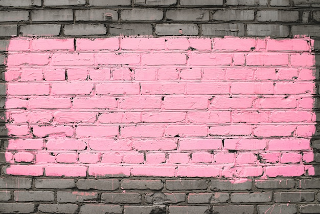 Old dirty brick wall painted in pink Premium Photo