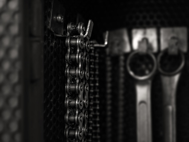 Old dirty chain hanging on tool board Premium Photo