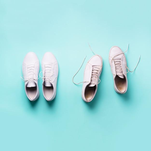 Old dirty sneakers vs new white sneakers. trendy footwear. Premium Photo