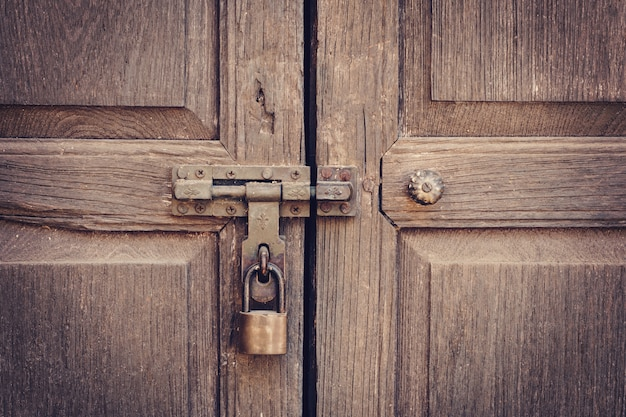 Premium Photo Old Door Knock And Key Lock Wall Texture And Background