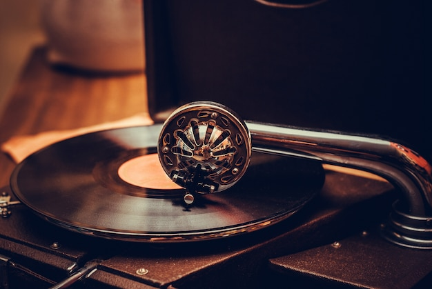 Old fashioned gramophone player close up. detail Premium Photo