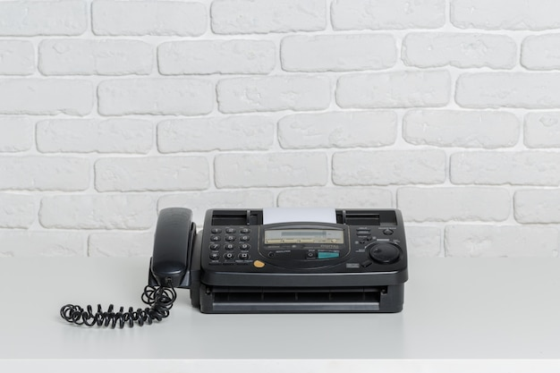 Old fax machine on the table Premium Photo
