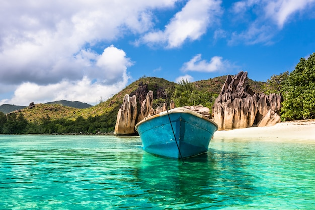 Old fishing boat on tropical beach Premium Photo