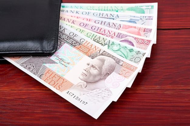 Old ghanaian cedis in the black wallet Premium Photo