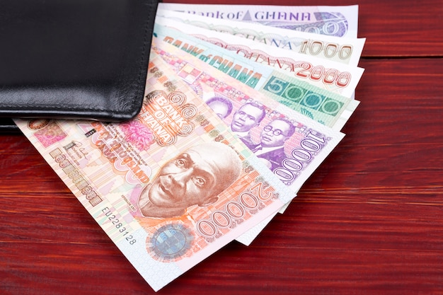 Old ghanaian money in the black wallet Premium Photo