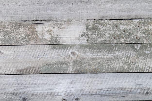 오래 된 회색 소박한 빈티지 나무 배경입니다. 풍 화 헛간 나무 널빤지 배경입니다. 프리미엄 사진