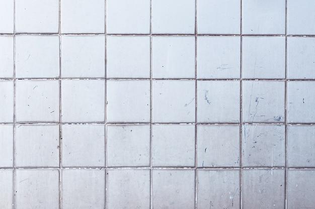 古いグランジセラミックタイル壁のテクスチャ背景 Premium写真