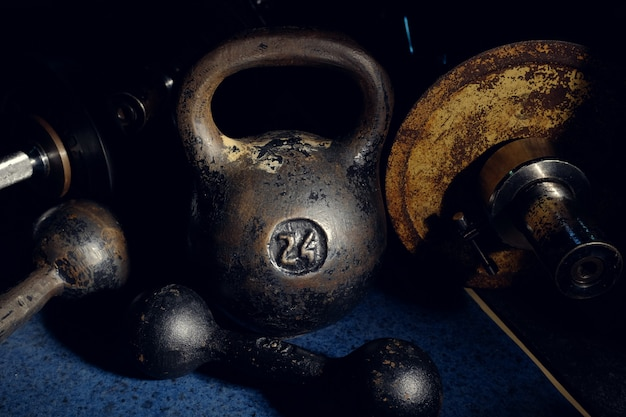 Old and heavy kettlebell weight in dark room. Premium Photo