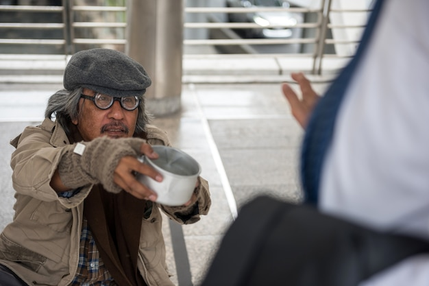 Old homeless man ask for money but refuse Premium Photo