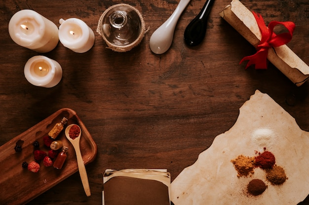 Old ingredients and candles on table Free Photo