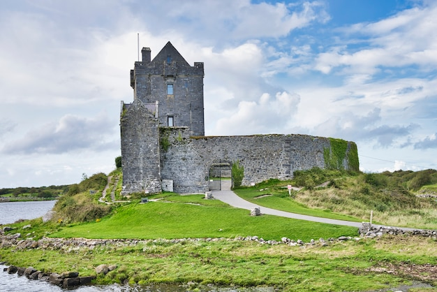 Old irish dunguaire castle and cloudy sky Premium Photo
