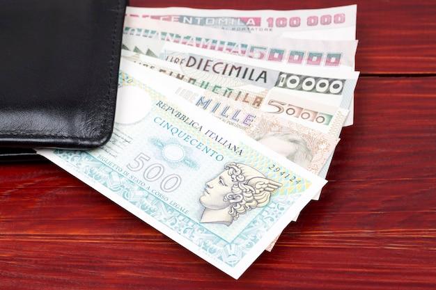 Old italian money in the black wallet Premium Photo
