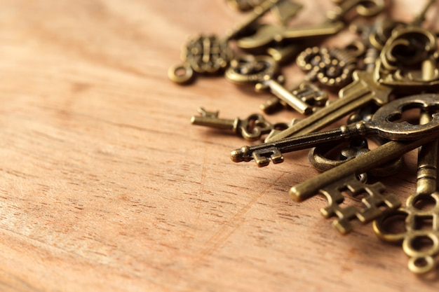 Old key on wooden table Premium Photo