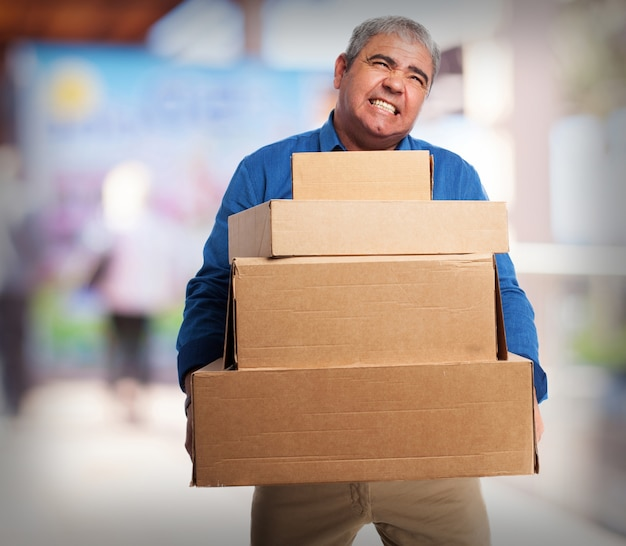 Old Man Carrying Many Cardboard Boxes Photo  Free Download-6241