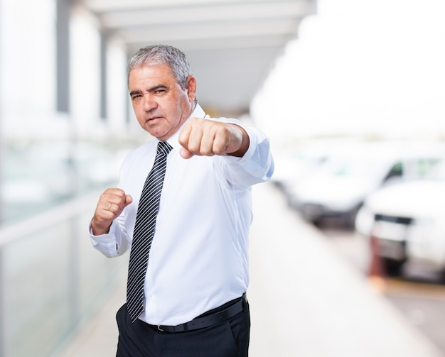 Old man in suit fighting photo free download old man in suit fighting free photo publicscrutiny Images