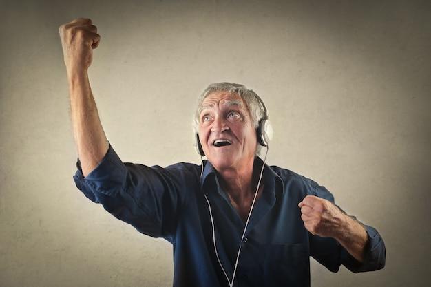 Old man listening to music Premium Photo