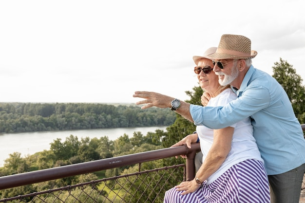 Old man pointing away to his woman Free Photo