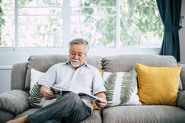 Old man reading at living room Free Photo