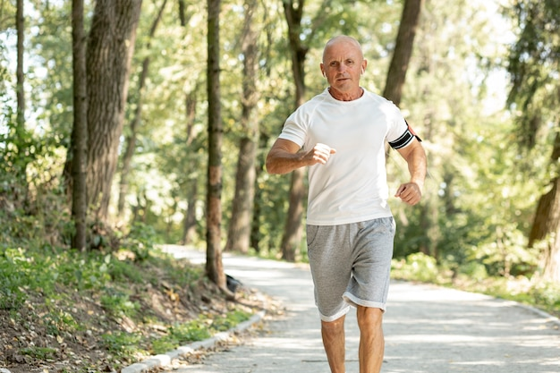 Old man running in the woods Free Photo