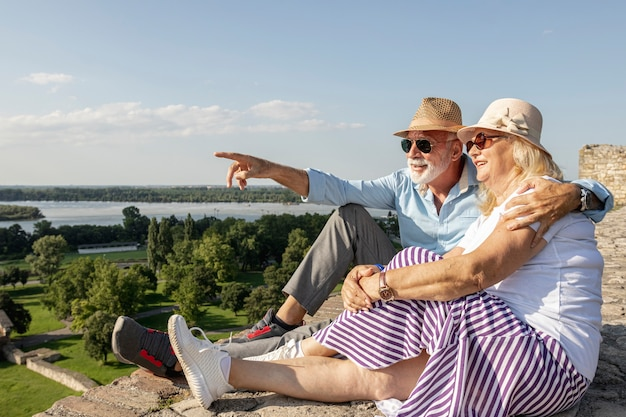 Old man showing woman a  view Free Photo