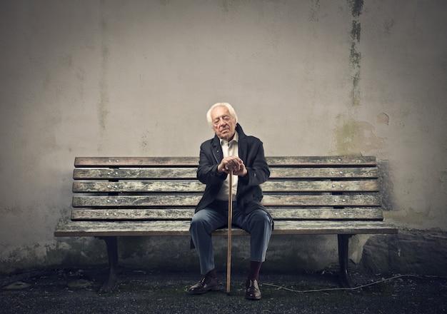 Old man sitting on a bench Premium Photo