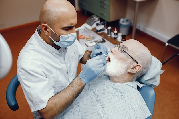 Old man sitting in the dentist's office Free Photo