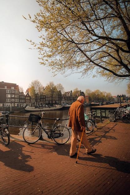 Old man walking in amsterdam Premium Photo