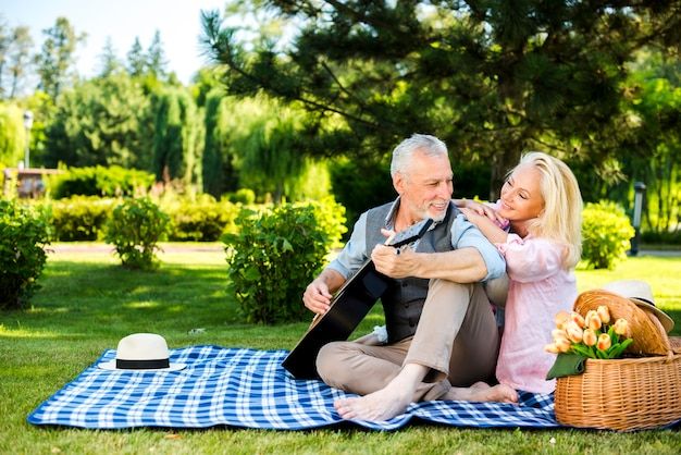 Old man and woman on a blanket at the picnic Free Photo