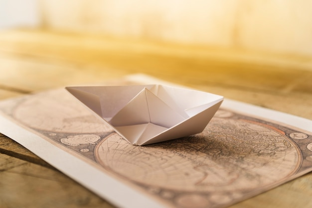 Old map with paper boat Free Photo