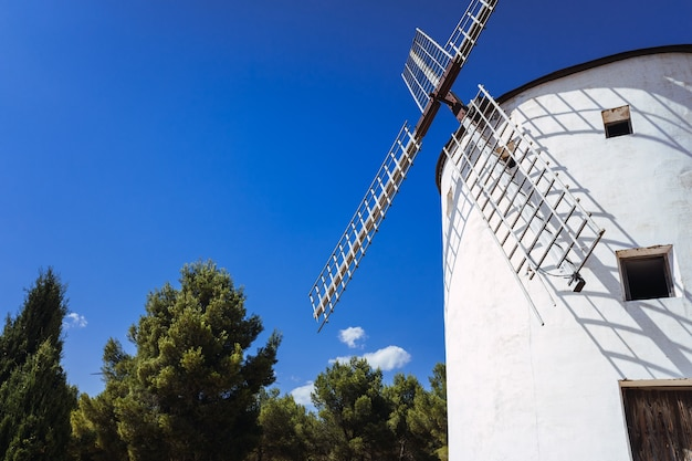 Old mill from la mancha, moved by the wind, to crush cereal. Premium Photo