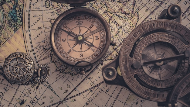 Old nautical maritime compass on world map Photo | Premium Download