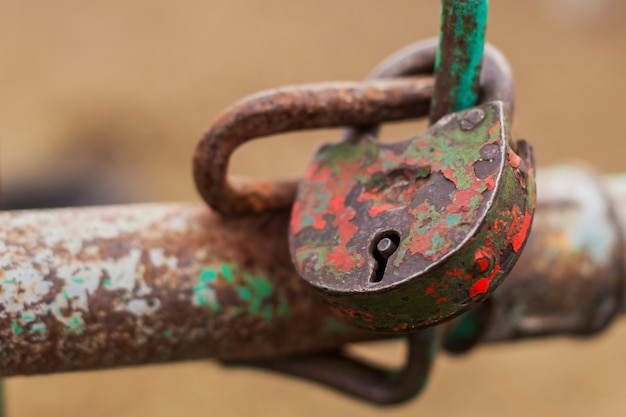 The old padlock is closed in red Premium Photo