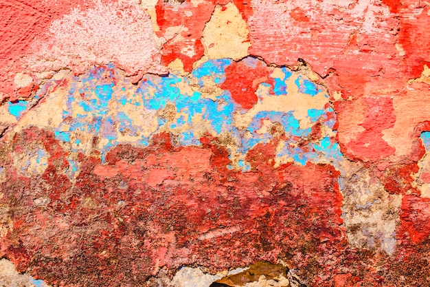 Old paint peeling from wall texture background Free Photo