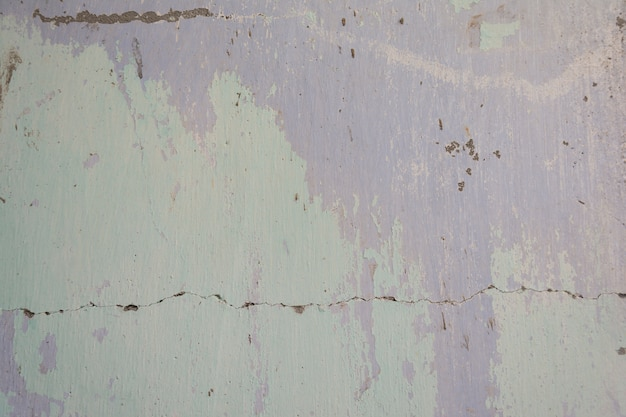 Old painted cement wall with all the old colors layers artistic backround Premium Photo